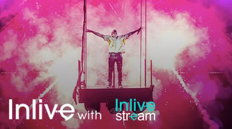 InLiveWith Inlive Stream - Homme sur une plateforme avec feux artifices